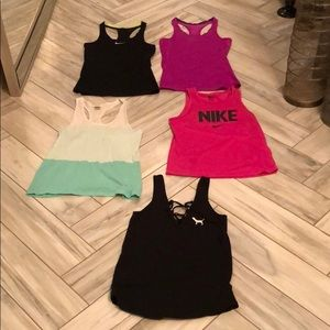 3 Nike and 2 Pink Tank Tops